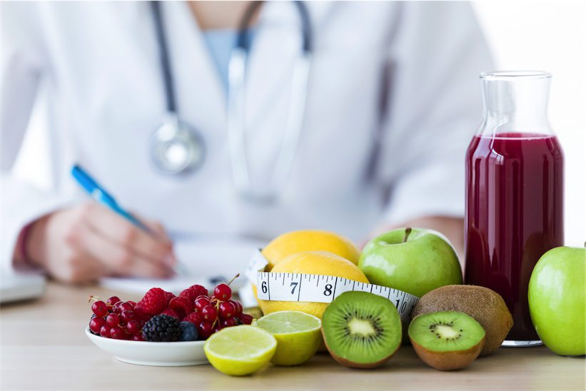 Naturopath with bowl of fruit