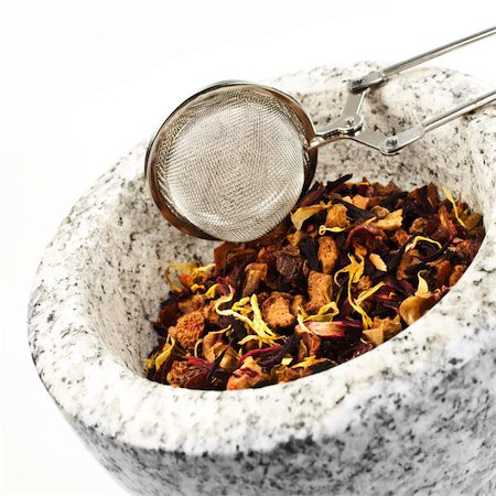 dried herbal medicine with mortar and pestle