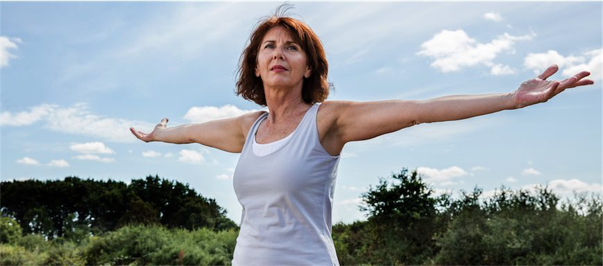 healthy menopause woman exercising in nature