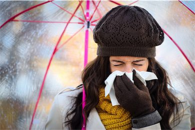 naturoapthy immune treatment woman under umbrella sneezing